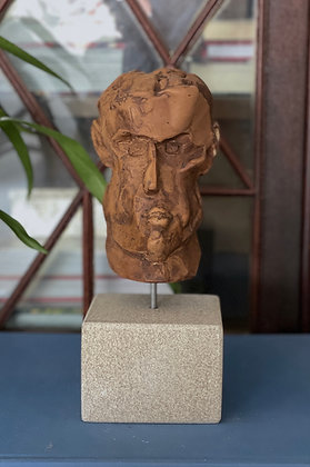 Miniature plaster bust soaked in coffee