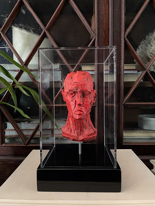 Miniature plaster bust with aged red enamel finish in display box
