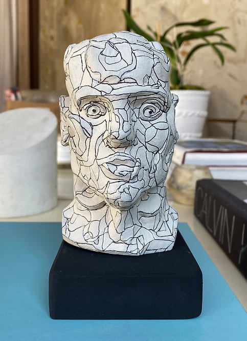 Miniature clay-cast plaster head