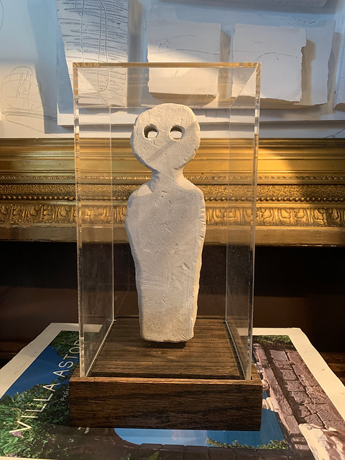 Small clay-cast plaster ghost with display case