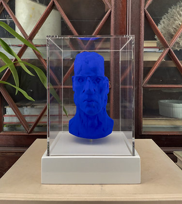 Miniature clay-cast plaster head in blue with display case
