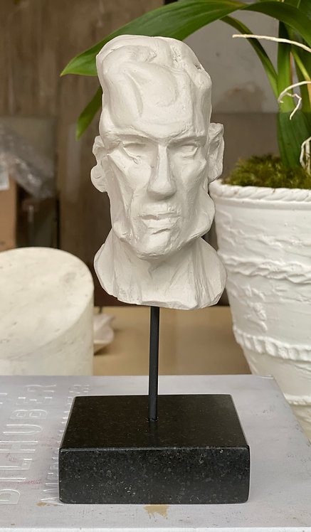 Miniature clay-cast plaster head