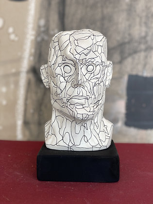 Miniature clay-cast plaster head with pen lines #1