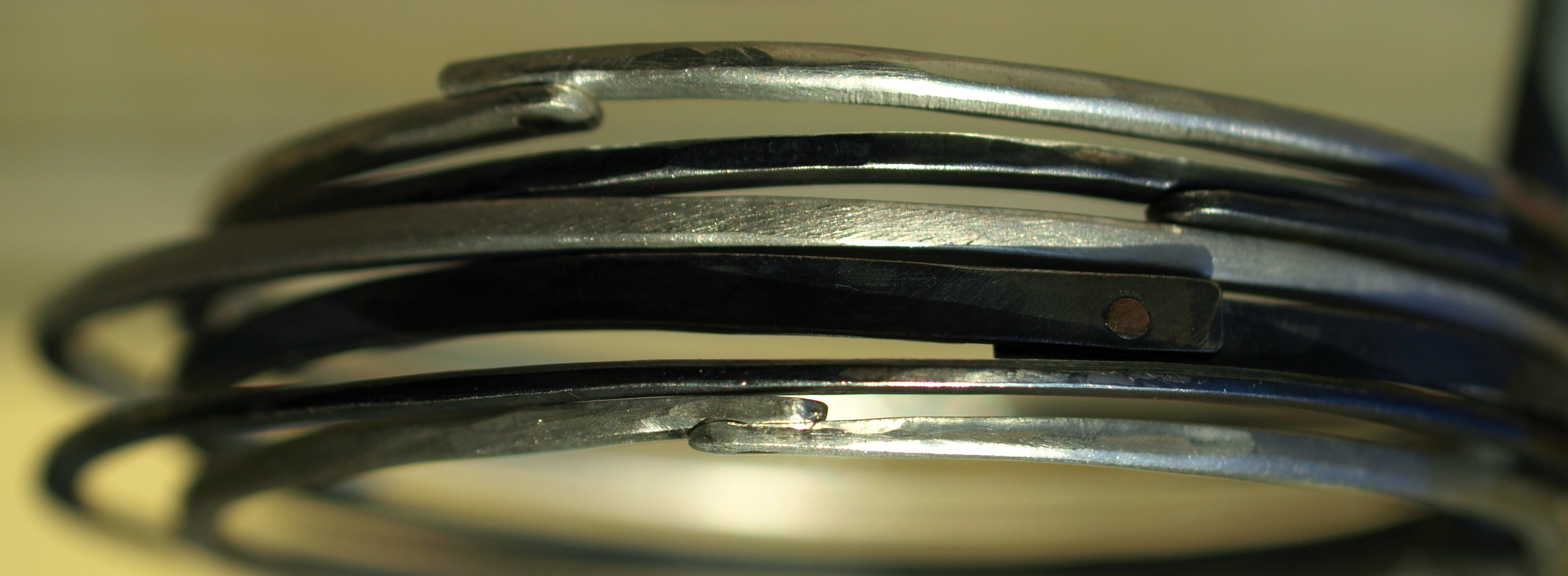 Silver rivett bangles