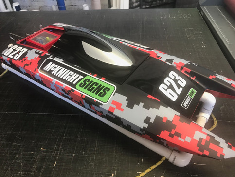 speed boat with red digital camo wrap with mcknight sticker