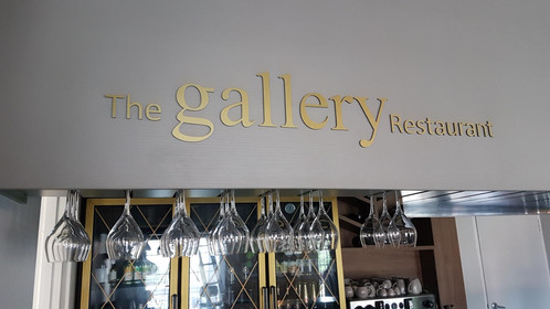 the gallery restaurant signage on grey background wall