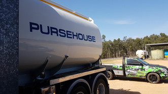 purehouse truck sign wrap with mcknight ute in the background