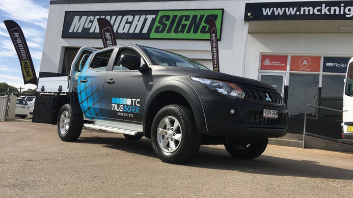 Tileworx blue and black ute vehicle wrap