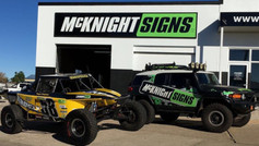 runamuk and mcknight sings vehicles pictured with new car wraps