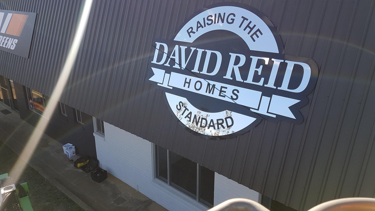 david reid homes logo sign on roof