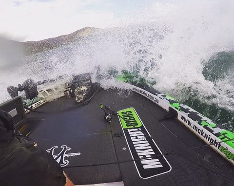 mcknight singage boat on the water with green digital camo