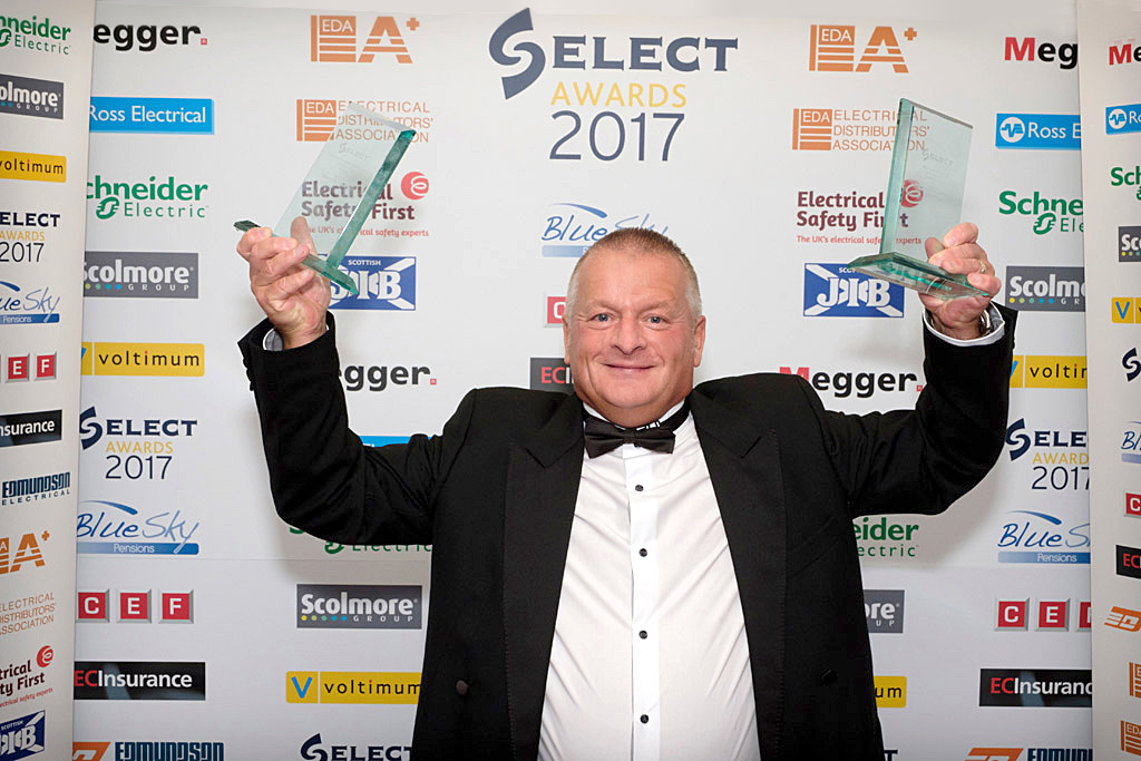 Mike Stark with the two awards for Servest Arthur McKay