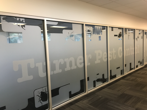vinyl wall mural on glass for Turner Pest Control