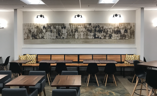 custom environmental design featuring an old employee photo for company breakroom