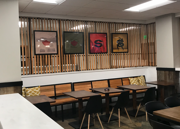 custom designed and fabricated wall divider and bench for a company's environmental design