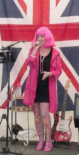 Leah with pink wig, singing solo