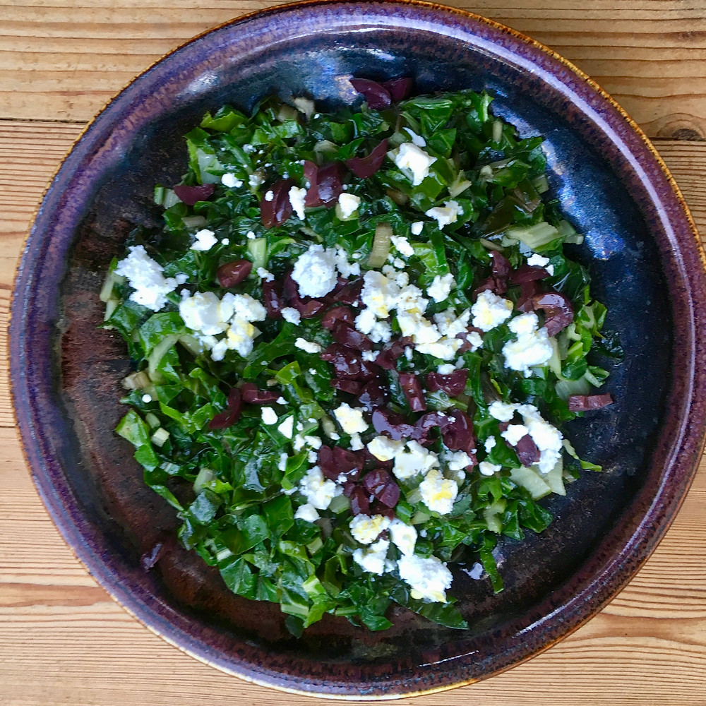 Spinach with olives and feta