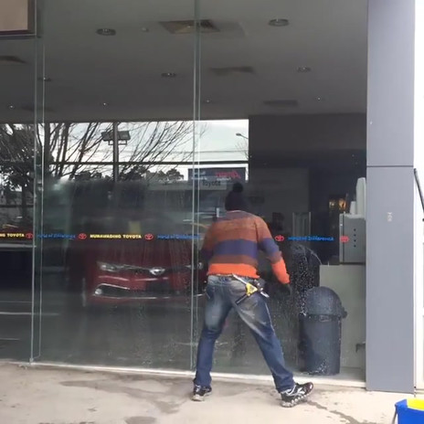 Craig Middelton cleaning the windows at