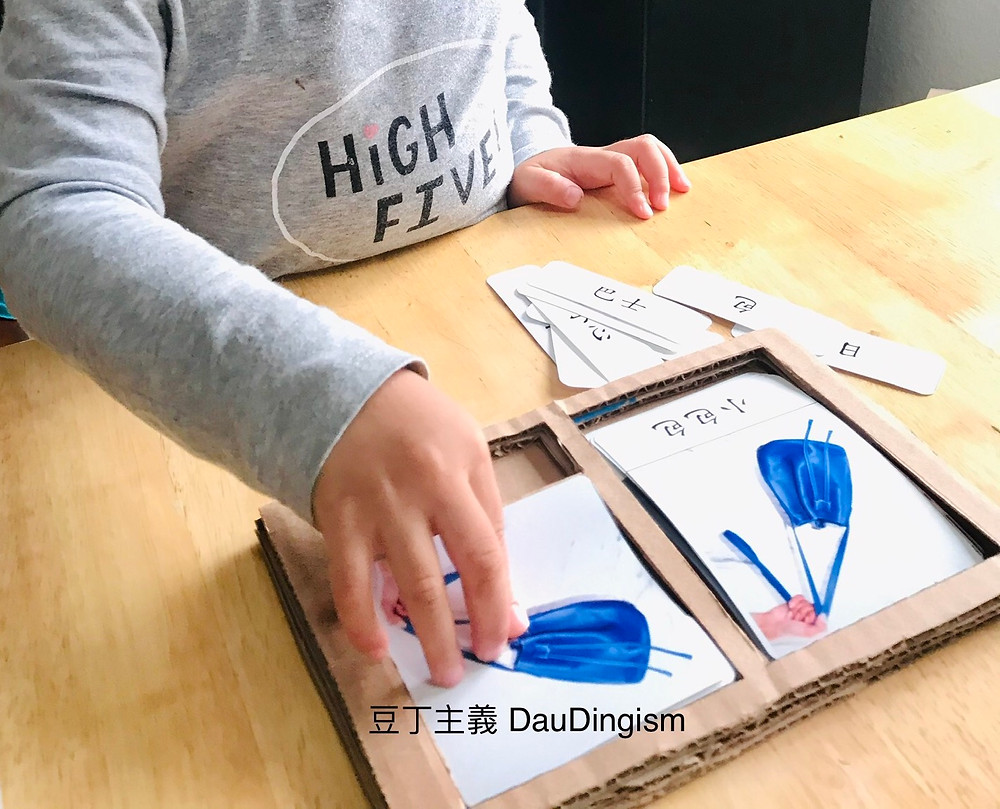 Child doing the three-part card activity