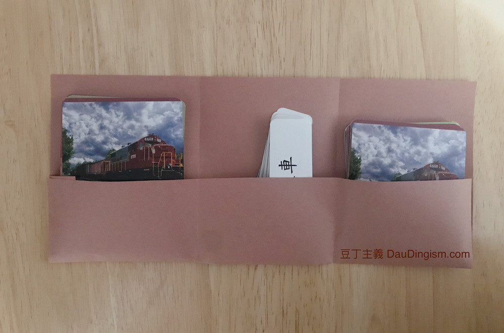 A paper card pocket storing three-part cards
