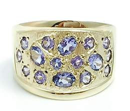 Jewellery Commission. Testimonial page. Cad designed gold ring set with tanzanite stones. Bespoke ring design.