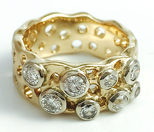 Remodelled gold into a ring. Yellow gold and diamonds bezel set.