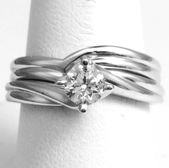 Shaped to fit wedding band, handmade.
