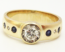 Jewellery Commission. Testimonial page. Family sentimental jewellery redesigned into a gold, sapphire and diamond bespoke ring design.