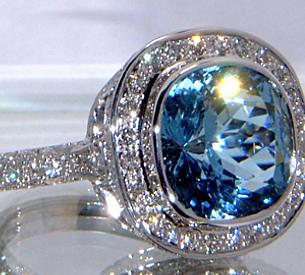 Jewellery Commission. Handmade aqua and diamond ring. 18ct white gold aqua marine and diamond halo. Bespoke ring.
