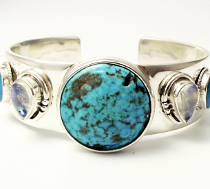 Jewellery Commission. Handmade silver ba gle wth turquoise and moonstone. Jewellery redesigning.