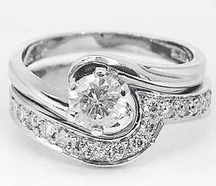 Hand made shaped to fit wedding ring. White gold and diamond. Bespoke.One off.