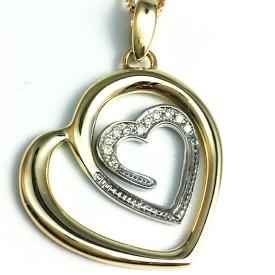 Jewellery Commission. Hand made heart pendant. Diamond set.
