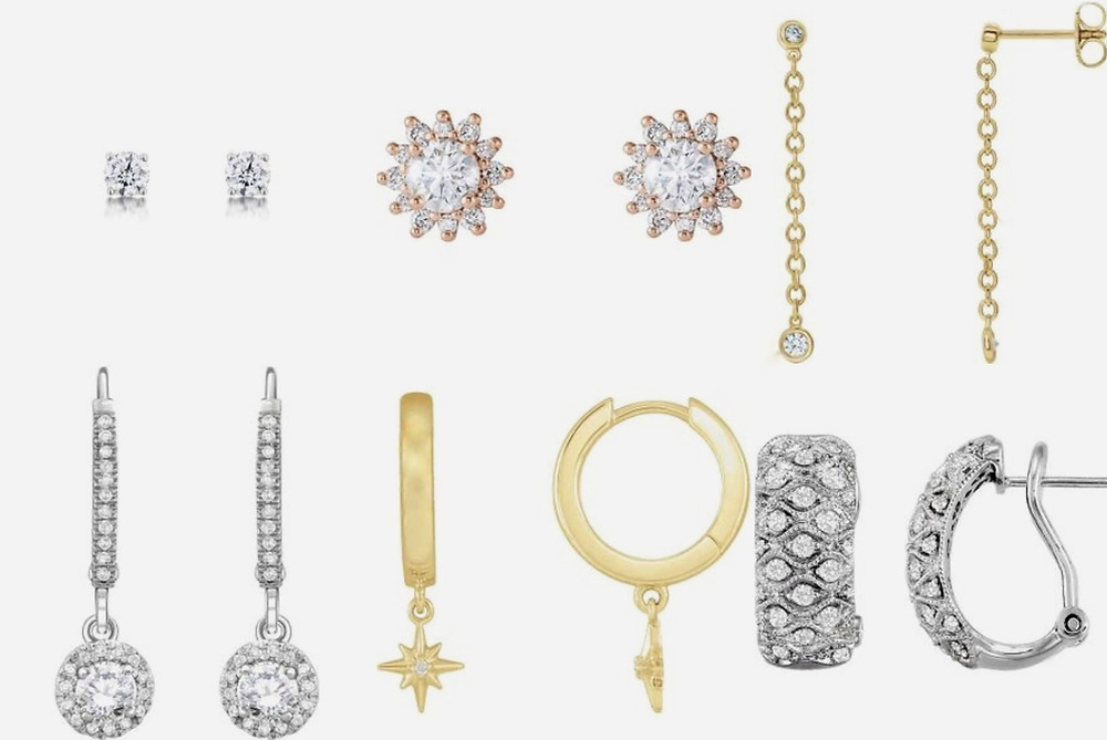 selection of diamond studs and diamond drop earrings on a white background