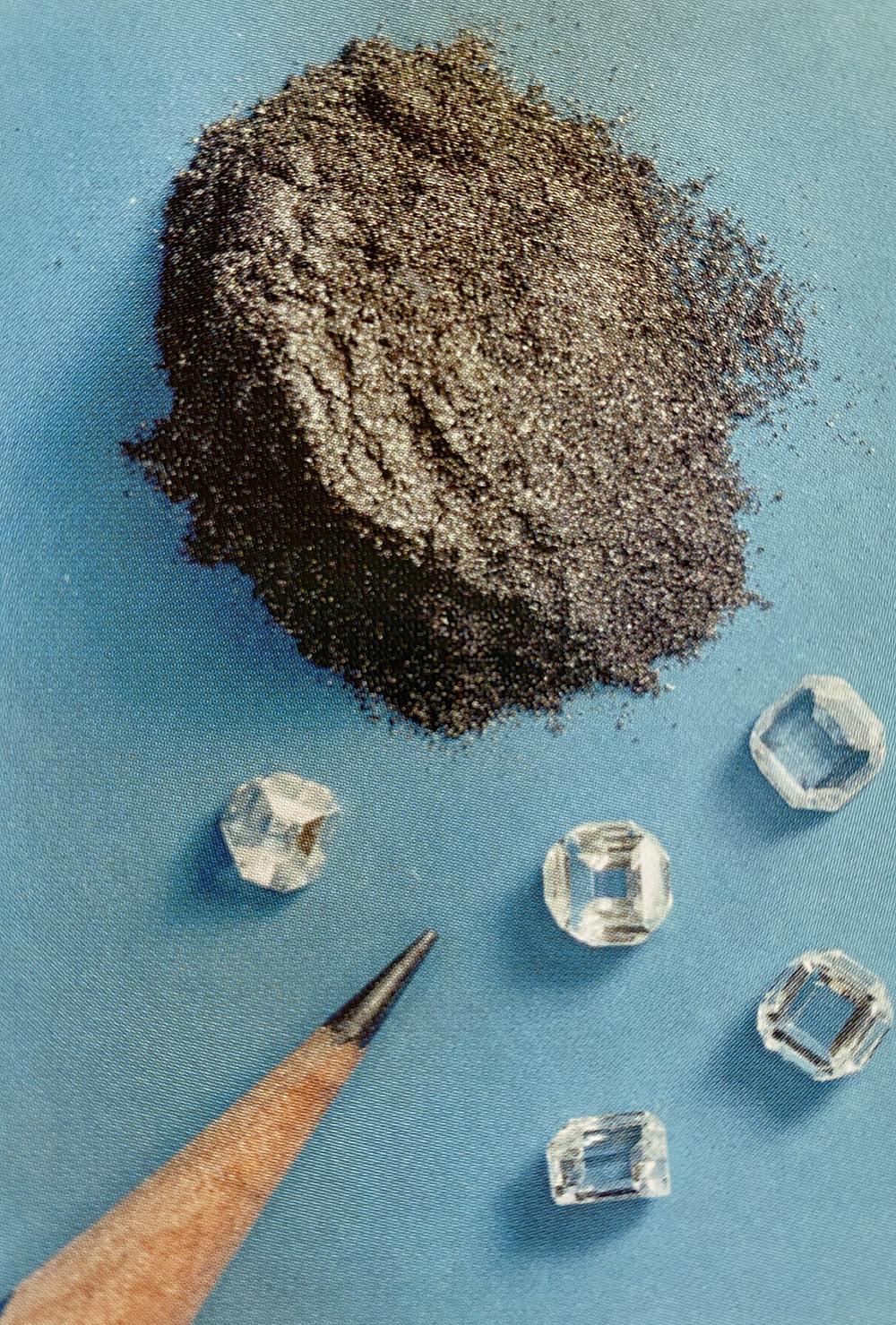 graphite pencil and loose diamond comparison on a blue background
