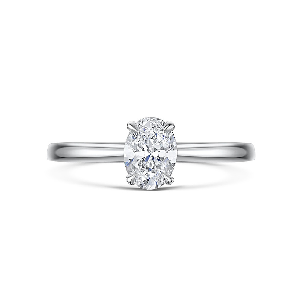 Oval diamond solitaire white gold engagement ring on a white background