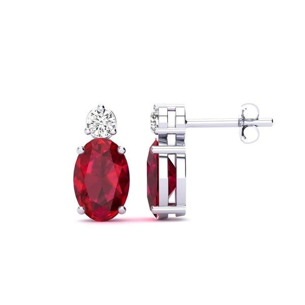 oval ruby and round diamond white gold earrings