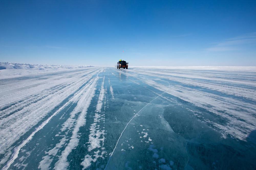 Vehicle on ice road to Ekati diamond mine in Northwest Territories Canada