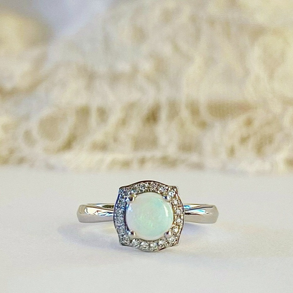 round opal and diamond halo white gold engagement ring