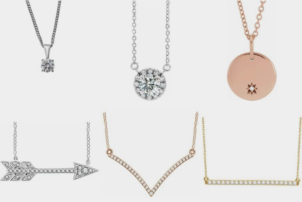 selection of diamond pendants solitaire halo in white yellow and rose gold arrow starburst and bar pendants with chain on white backgound
