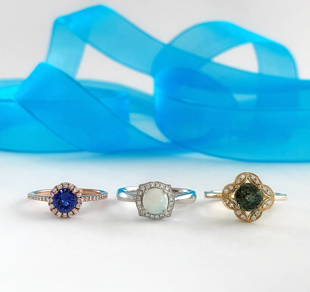 round purple sapphire diamond halo rose gold ring round opal halo white gold ring round green sapphire vintage yellow gold on white gold and blue ribbon by Tsarina Gemshalo