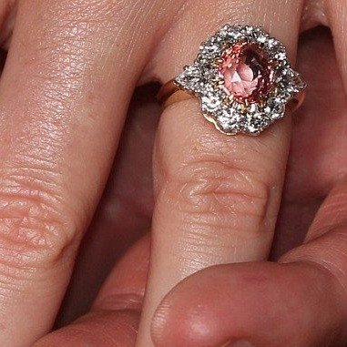 Princess Eugenie wearing Padparadscha sapphire engagement ring