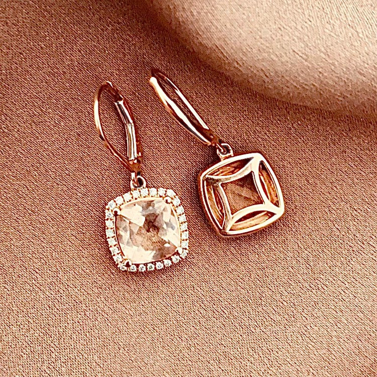 a pair of cushion shape morganite and diamond halo rose gold drop earrings on rose gold silk background