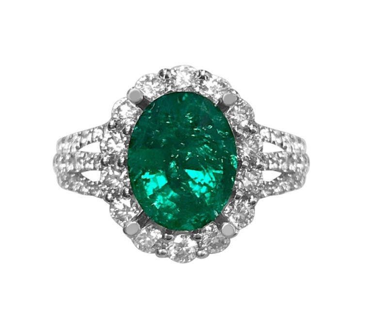 dark green oval emerald cocktail or engagement ring in white gold with diamond halo and diamond splint shank by Tsarina Gems