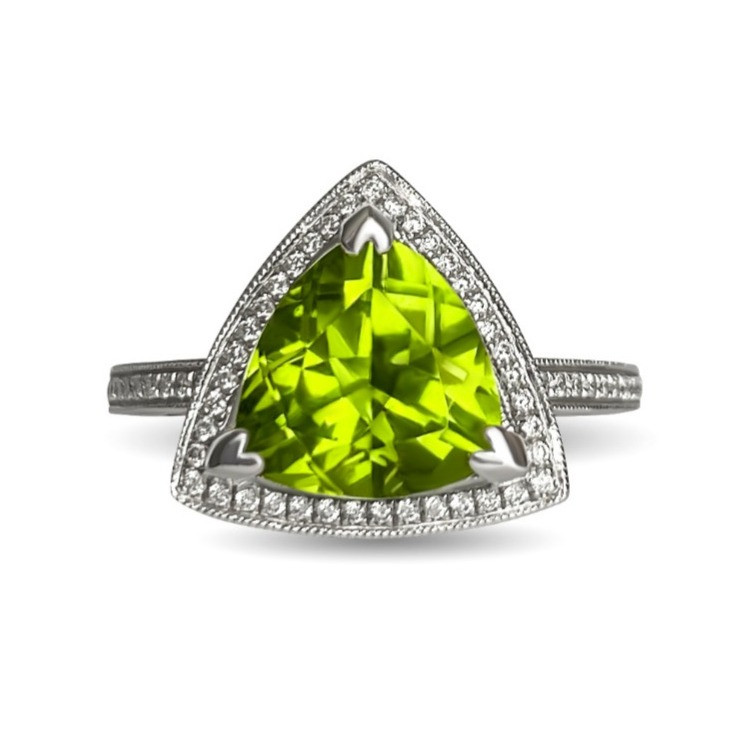 trilliant cut yellowish green peridot surrounded by diamond halo in white gold by Tsarina Gems