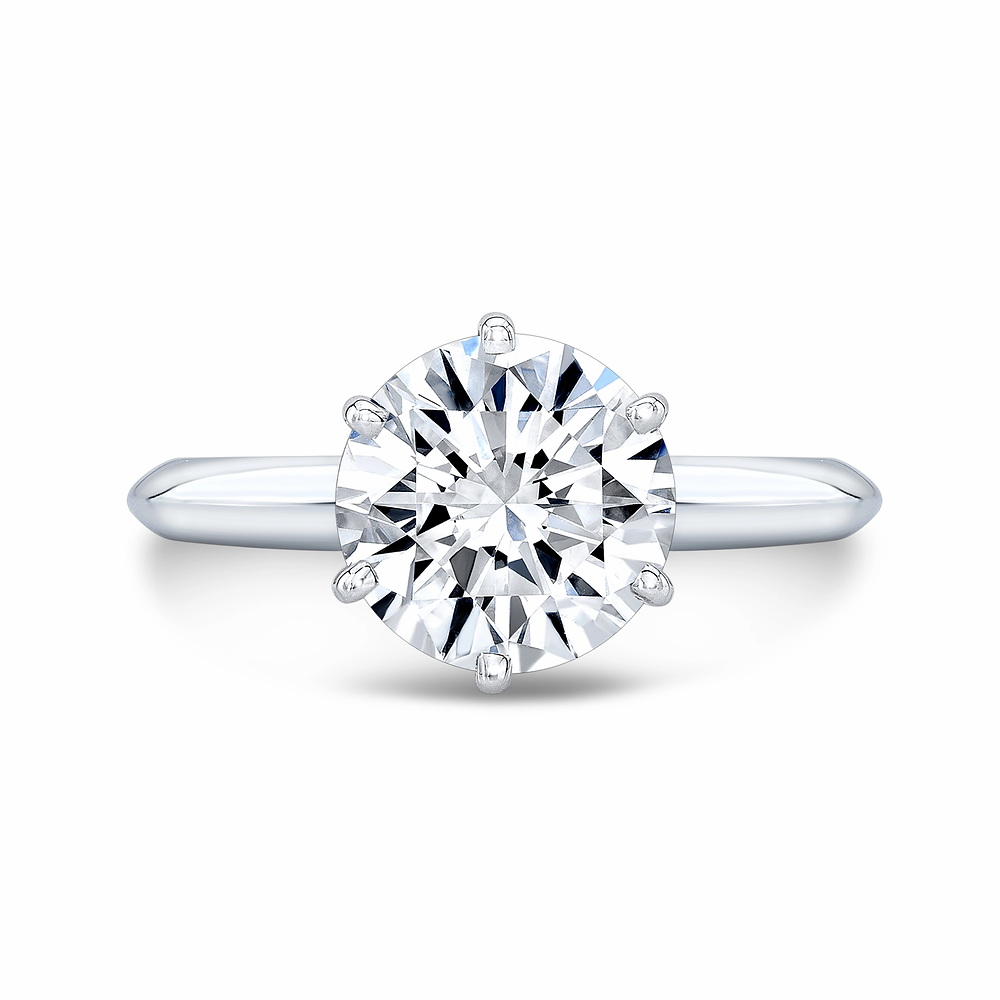 round diamond solitaire white gold 6 prong engagement ring on a white background