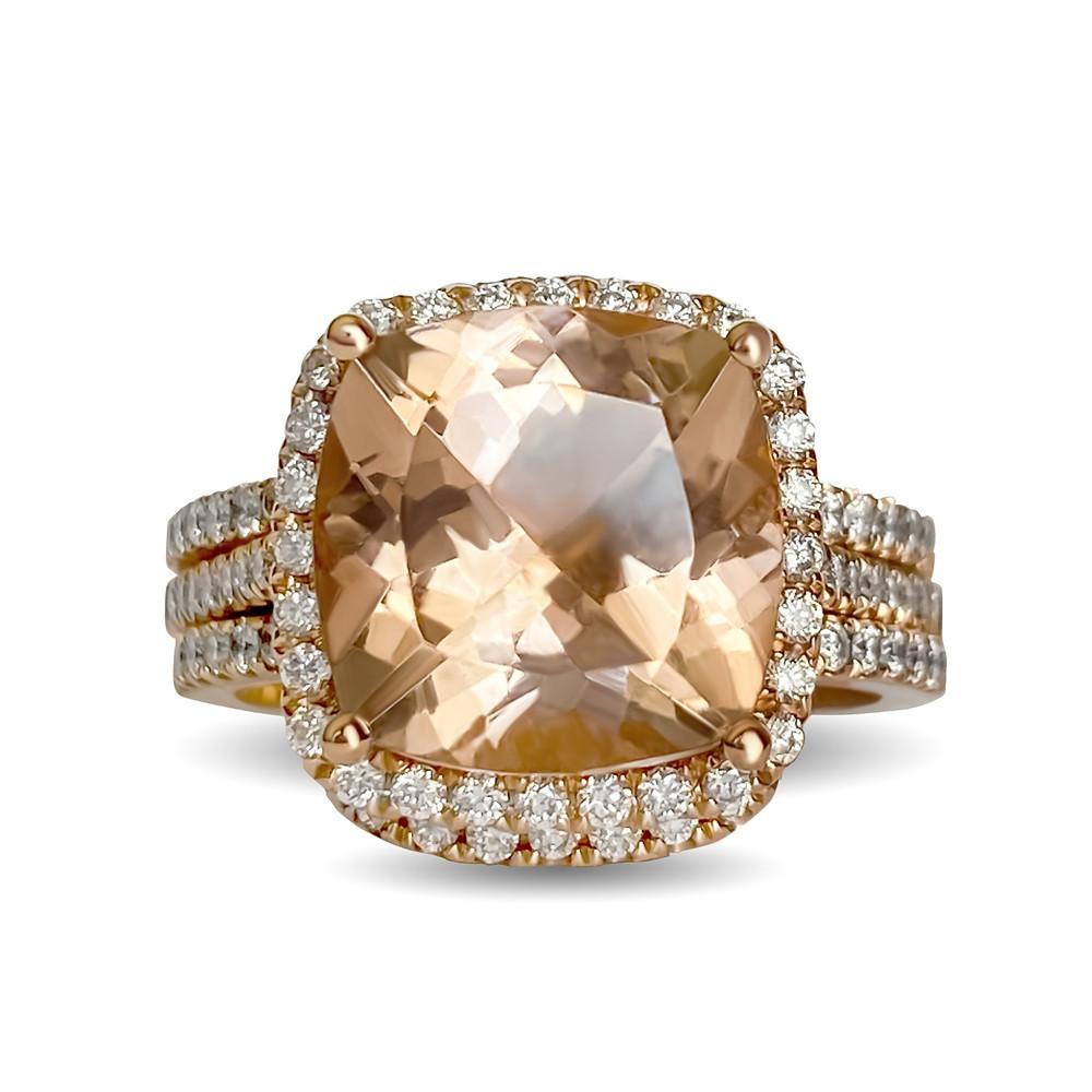 vintage inspired cushion shape morganite and diamond halo rose gold engagement ring and wedding band bridal set on a white background