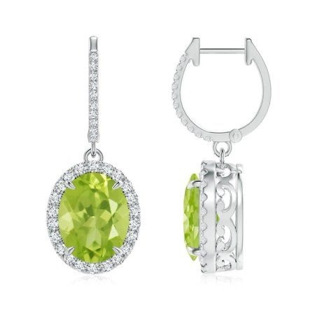large oval peridot and diamond halo white gold drop earrings on a white background