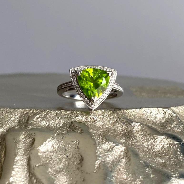 trilliant cut peridot and diamond halo white gold ring