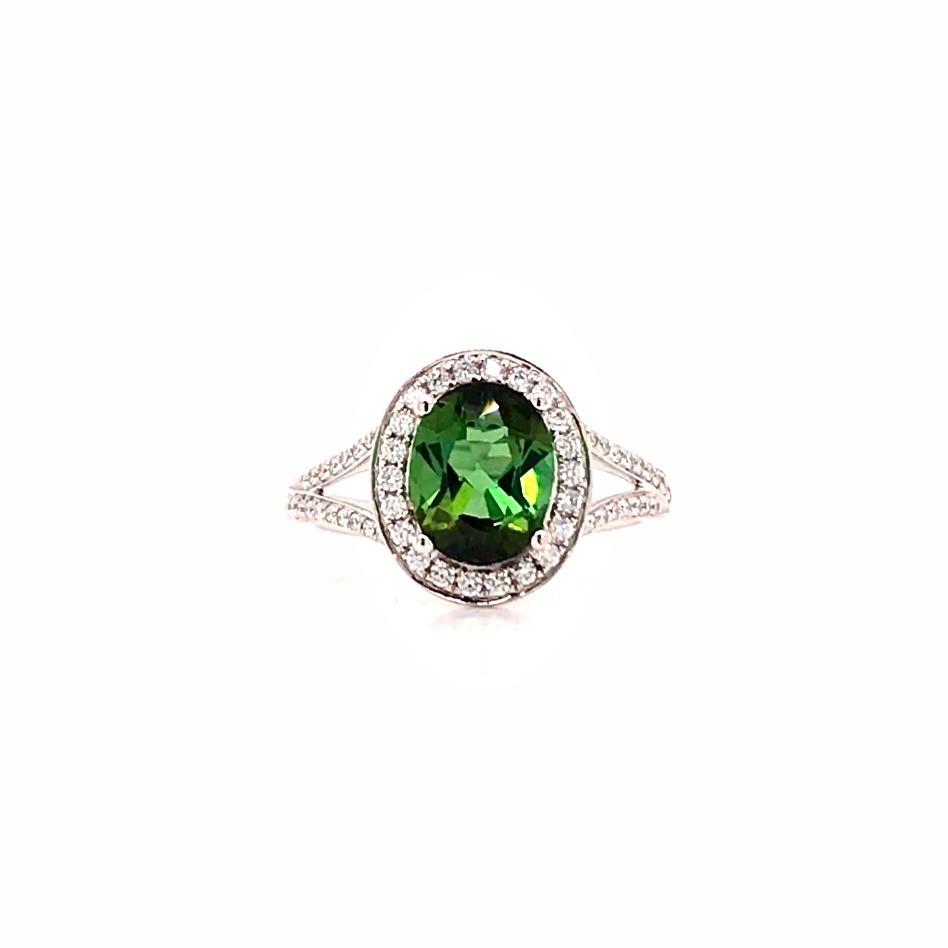 oval green tourmaline and diamond halo split shank white gold ring
