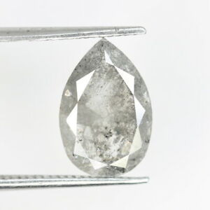 a pear shape salt and pepper diamond held in tweezers on a white background